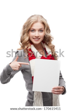 young happy smiling casual  blond woman pointing at sign isolated on white - stock photo