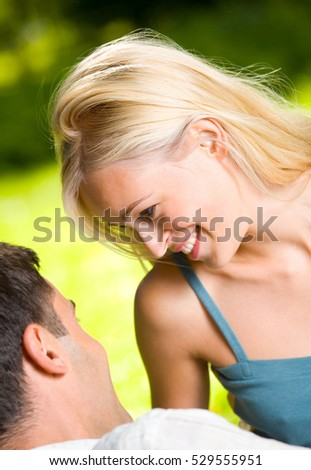 Young happy smiling couple outdoors together. Love, flirt, romantic, relations theme concept.