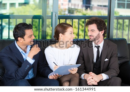 Young happy, smiling couple sitting on sofa with legal financial adviser, broker, ready to sign a document . House mortgage refinance. Financial decisions. Investment opportunities. Brokerage account. - stock photo