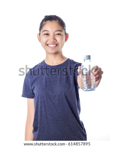 Young happy smiling girl holding a bottle of water