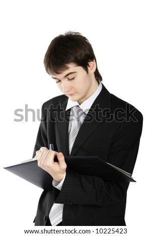 Young happy smiling man writing, isolated on a white background