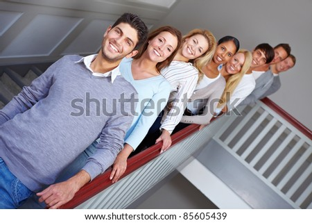 Young happy smiling teenager people in a row - stock photo
