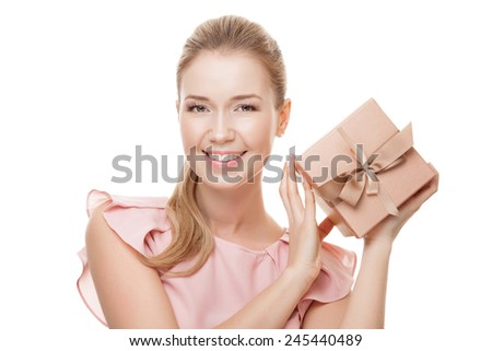 Young happy smiling woman with a gift in hands. Isolated on white background. - stock photo