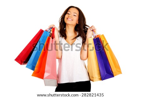 Young happy smiling woman with shopping bags. - stock photo
