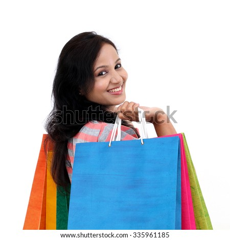 Young happy smiling woman with shopping bags - stock photo