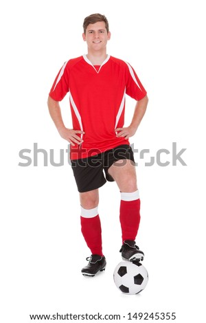 Young Happy Soccer Player Holding Football Over White Background - stock photo