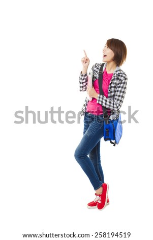 Young happy student with books and pointing something - stock photo