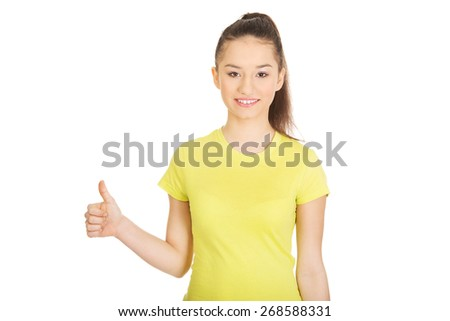 Young happy student woman showing thumbs up. - stock photo