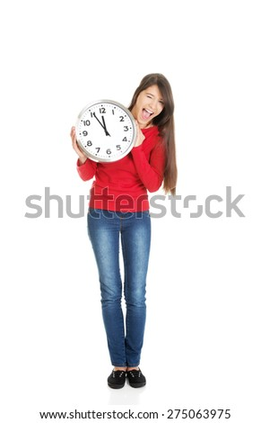 Young happy student woman with the clock. - stock photo