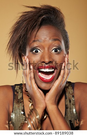 Young happy stylish african woman looking surprised - stock photo