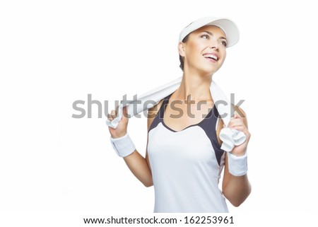 Young Happy Tanned Caucasian Female Tennis Player Equipped with Professional Tennis Outfit with Towel on Shoulders. Isolated on White. Horizontal Image