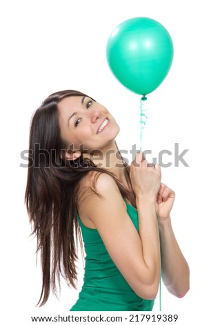 Young happy teenage woman hold green balloon in hands for birthday party smiling  on a white background - stock photo