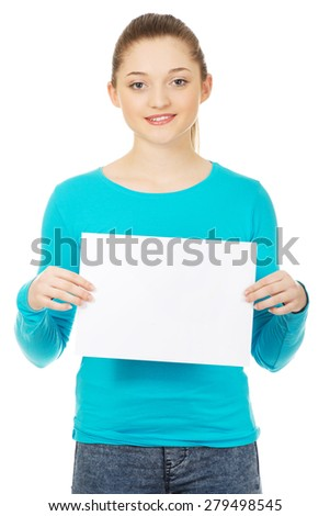 Young happy teenage woman with blank board. - stock photo