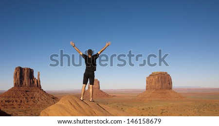 Young Happy Tourist in Monument Valley Tribal Park - stock photo