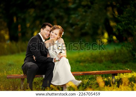 Young Happy wedding couple. - stock photo