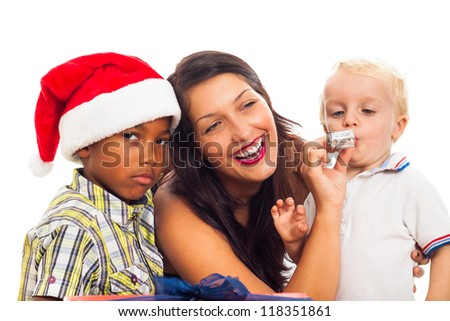 Young happy woman celebrating Christmas with children, isolated on white background. - stock photo
