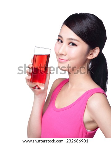 Young happy woman drink juice ( red cranberry ) isolated on white background, asian - stock photo