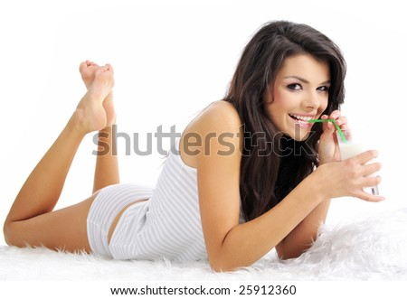 Young happy woman drinking milk - stock photo