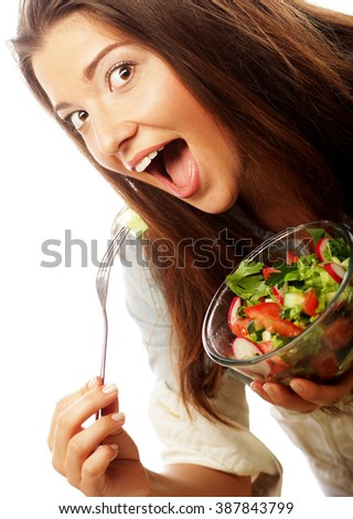 Young happy woman eating salad. - stock photo
