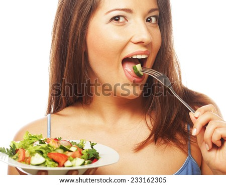 Young happy woman eating salad.Healthy lifestyle. - stock photo
