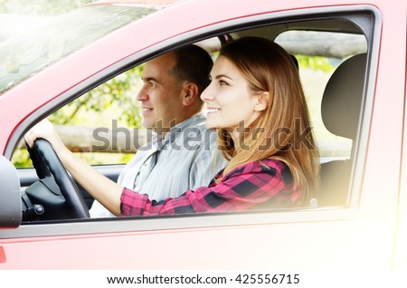 Young happy woman having driving lesson