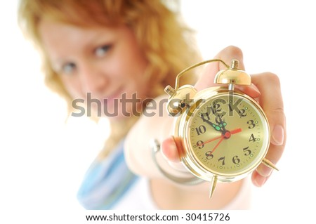 young happy woman hold clock isolated on white