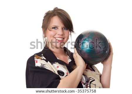 Young happy woman holding a bowling ball and wearing a bowling shirt; isolated on a white background - stock photo