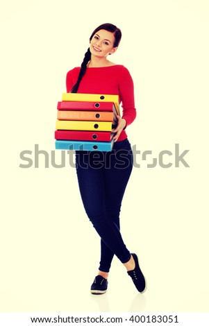 Young happy  woman holding binders