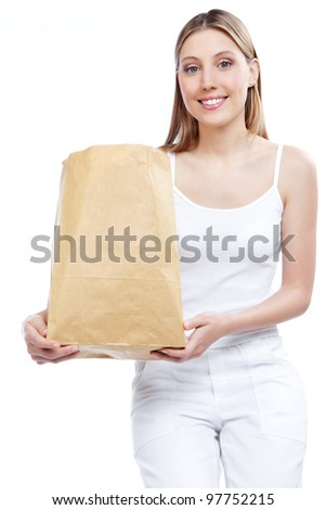 Young happy woman holding shopping paper bag. - stock photo