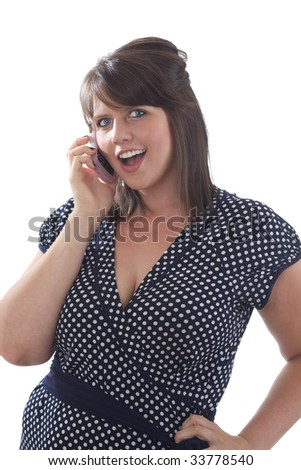Young happy woman in business attire talking on her cell phone; isolated on a white background. - stock photo