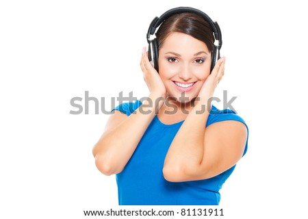 young happy woman in headphones listening music. isolated on white background - stock photo