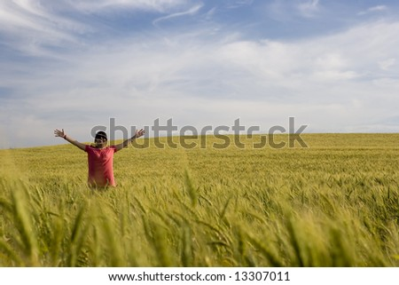 young happy woman in the middle of the field - stock photo
