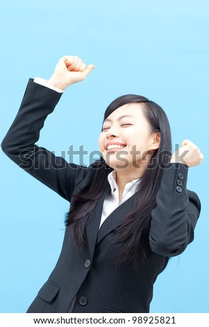 young happy woman isolated on blue background. - stock photo