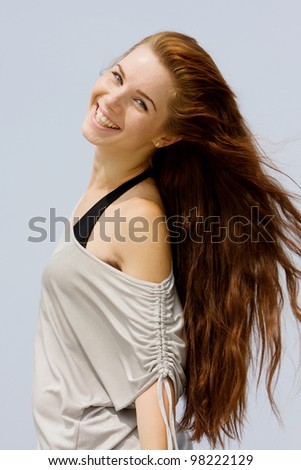 young happy woman isolated over sky background - stock photo