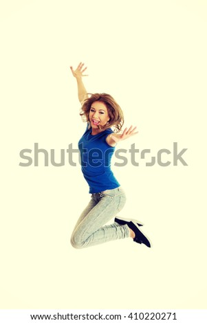 Young happy woman jumping.