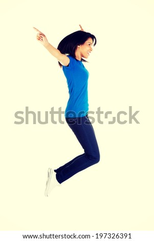 Young happy woman jumping in the air.