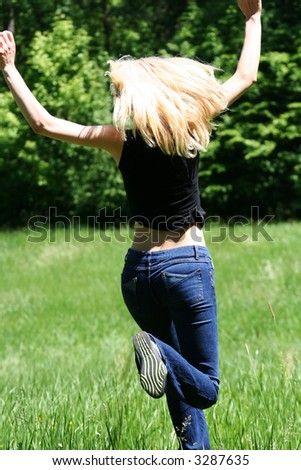 young happy woman jumping in wood