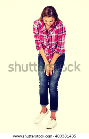 Young happy woman looking down - stock photo