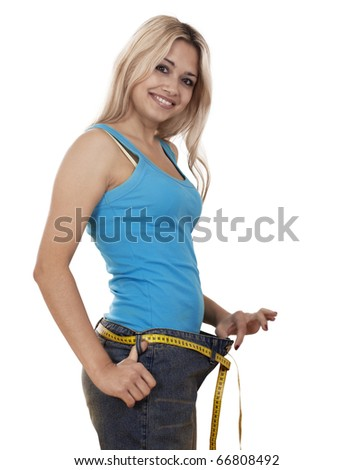Young happy woman measuring her waist over white background - stock photo