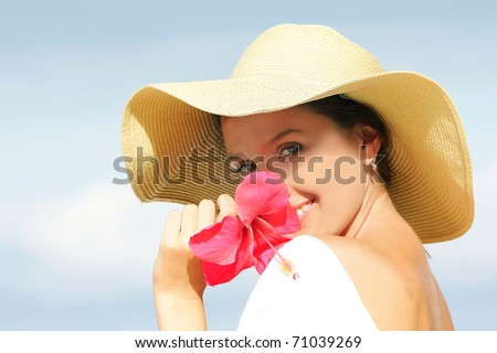 young happy woman on sky background - stock photo