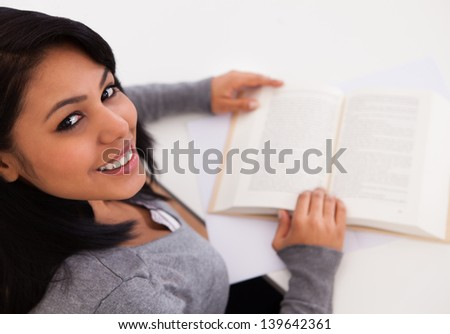 Young Happy Woman Reading Book At Home