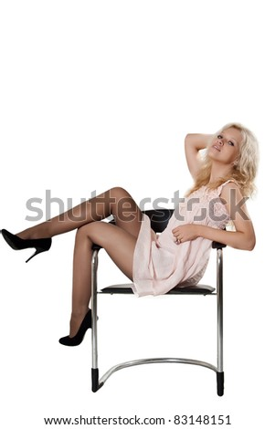 Young happy woman sitting on a armchair, on a white background - stock photo