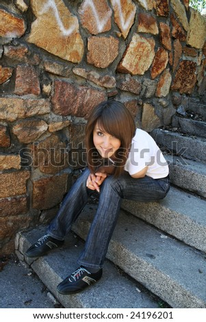 young happy woman sitting on the stair