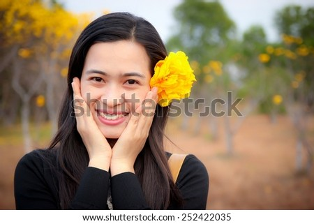 Young happy woman smiling with flower. - stock photo