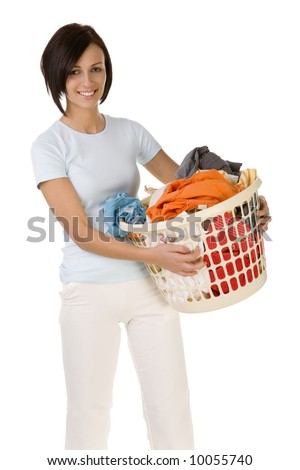 Young happy woman standing with full laundry basket. Looking at camera. Front view, white backgroun. - stock photo