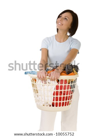 Young happy woman standing with full laundry basket. She's looks like moony. Front view, white backgroun. - stock photo
