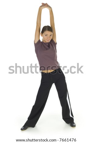 Young, happy woman stretching and looking at camera. Isolated on white in studio, front view. Whole body - stock photo