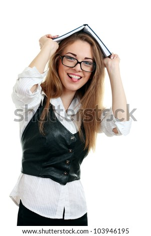 Young happy woman (student) with books on her head in glasses showing tongue , isolated on white - stock photo