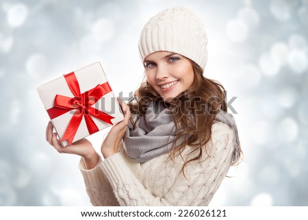 Young happy woman with a gift. Christmas. - stock photo