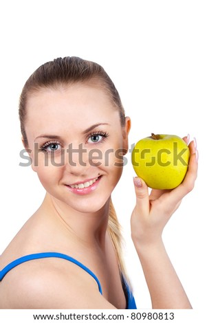 Young happy woman with apple isolated on white